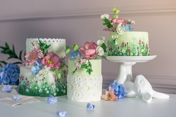 Wedding spring cake decorated with colorful flowers and hydrangeas. Desserts for a festive summer mood