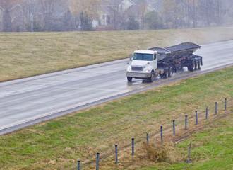 Wet Speeding Dump Truck