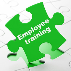 Learning concept: Employee Training on Green puzzle pieces background, 3D rendering