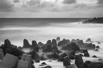 Beautiful contrast black and white photo in long exposure shot of GLAGAH beach, Java, Indonesia.
