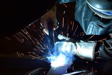 Industrial steel welder in factory technical,
