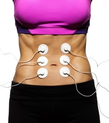 Midsection of woman with monitoring electrodes attached to her stomach