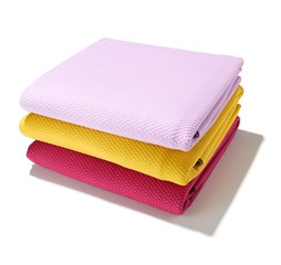 Three folded cloth napkins on white background