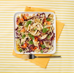 Plate of chicken salad on yellow striped background