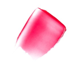 Smeared pink cosmetics on white background