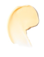 Smeared yellow lotion on white background