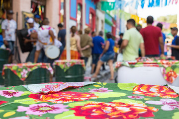 A bar table with colorful tablecloth, Brazil.