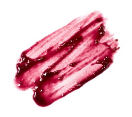 Smeared red berry cosmetics on white background