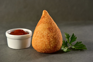 Coxinha on slate background