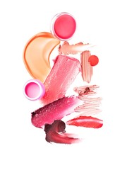 Smeared pink and red cosmetics on white background