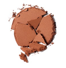 Broken brown powdered cosmetics on white background