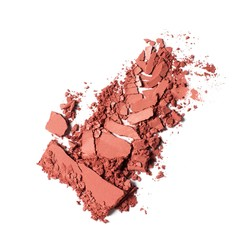 Broken pink powdered cosmetics on white background