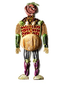 Anthropomorphic person with body made of bread loaf, vegetables, grains