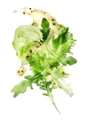 Lettuce with smeared salad dressing on white background