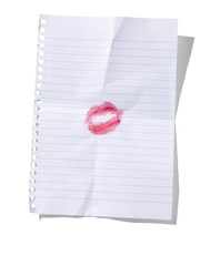 Lipstick kiss imprint on sheet of white lined paper