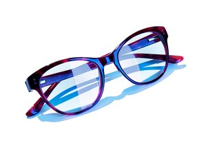 Blue plastic eyeglass frames against white background