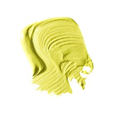 Smeared yellow cream cosmetics on white background