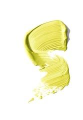 Smeared yellow cream cosmetics on white background