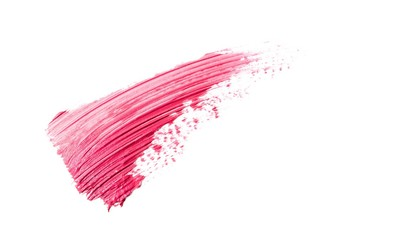 Smeared red cosmetics on white background