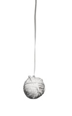 Hanging ball of white dental floss on white background