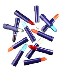 Pile of lipstick tubes on white background