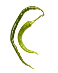 Two green cayenne peppers on white background