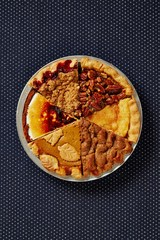Top view pie with variety of slices studio shot