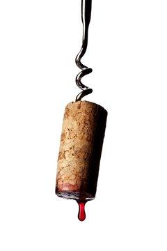 Close up cork corkscrew dripping red wine