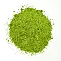 Pile of green matcha on white background