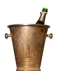 Opened bottle of alcohol in metal bucket