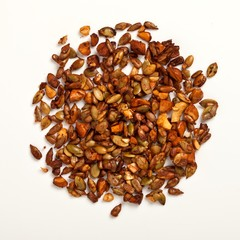 Pile of roasted nuts on white background