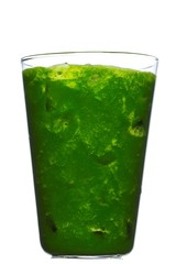 Glass of green juice on white background