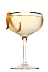 Low angle martini glass with orange peel garnish on white background