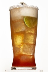 Glass of michelada on white background