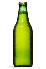 Low angle green beer bottle with condensation on white background