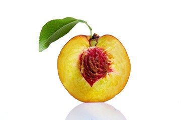 Peach half on white background