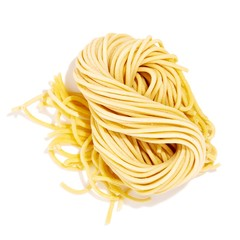 Twisted pile of linguine pasta on white background