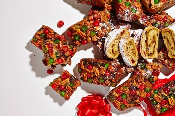 Fruitcakes and pastries on white background