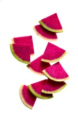 Radish slices on white background