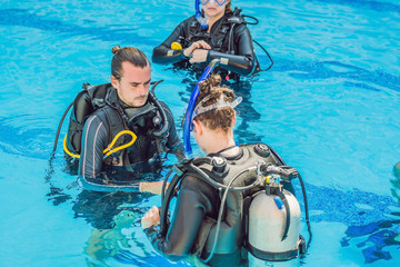 Diving instructor and students. Instructor teaches students to dive Wall mural