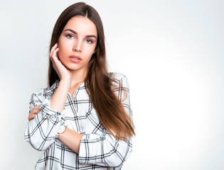 beautiful young woman with long hair wearing wrist watch posing on background with copy space
