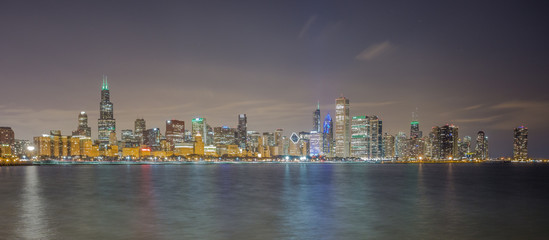Panoramic long exposure of Chicago skyline by night seen from Lake Michigan