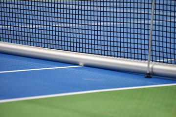 Tennis blue hard court with net