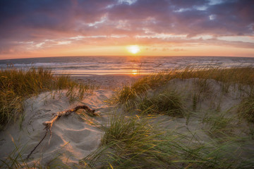 Beautiful sunset at white sanded beach with colorful sky