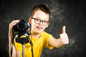 Teenage boy using big digital camera