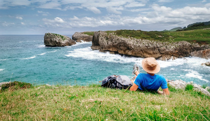 Backpacker traveler enjoy with beautiful sea landscape Wall mural