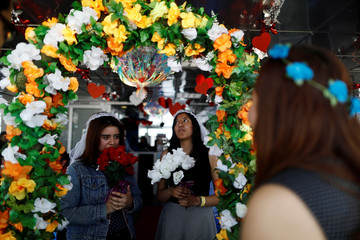 A lesbian couple take part in a symbolic wedding event on Valentine's Day in Mexico City
