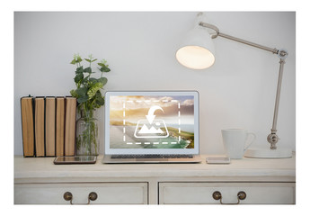 Laptop Mockup on Table with Books and Lamp