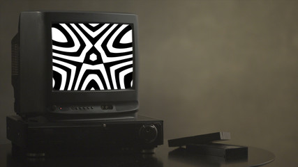 TV shows abstract pictures. TV shows a zombie video on the monitor. TV shows video hypnotizing consciousness