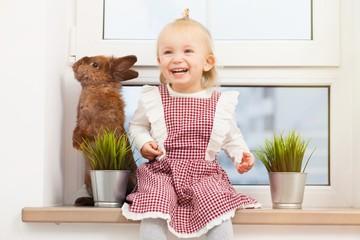 Cute little girl with a bunny